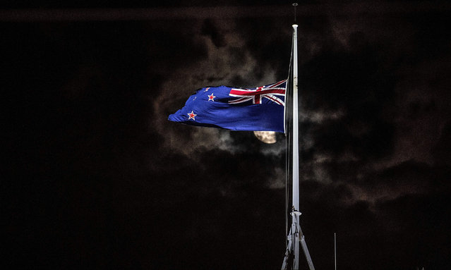 The New Zealand national flag is flown at half-mast on a Parliament building in Wellington on March 15, 2019, after a shooting incident in Christchurch. Attacks on two Christchurch mosques left at least 49 dead on March 15, with one gunman – identified as an Australian extremist – apparently livestreaming the assault that triggered the lockdown of the New Zealand city. (Photo by Marty Melville/AFP Photo)