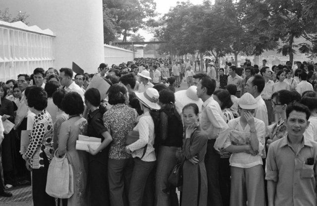South Vietnamese throng to U.S. embassy in Saigon on Thursday, April 24, 1975 seeking entry documents and possible evacuation from troubled city. Crowds grow daily as military, political situation in capital slides downhill. (Photo by Ky Nhan/AP Photo)