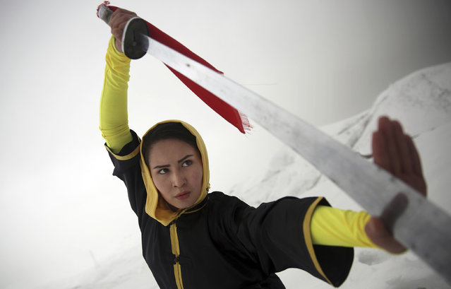 Shaolin martial arts trainer, Sima Azimi, 20, performs on a hilltop in Kabul, Afghanistan, Tuesday, January 25, 2017. Azimi said it was difficult to find all the tools needed to train. For instance, she had to order her Shaolin sword from Iran, where she had studied the art for three years. (Photo by Massoud Hossaini/AP Photos)