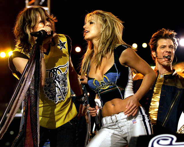 Aerosmith's Steven Tyler, left, Britney Spears, center, and NSYNC's JC Chasez perform during halftime of Super Bowl XXXV, January 28, 2001 in Tampa, Florida. (Photo by Joe Traver/Liaison)