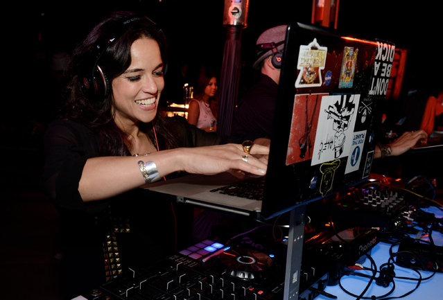 """Actress Michelle Rodriguez DJ's at the after party for the premiere of Universal Pictures' """"Fast & Furious 6"""" at the Gibson Amphitheatre on May 21, 2013 in Universal City, California. (Photo by Kevin Winter/Getty Images)"""