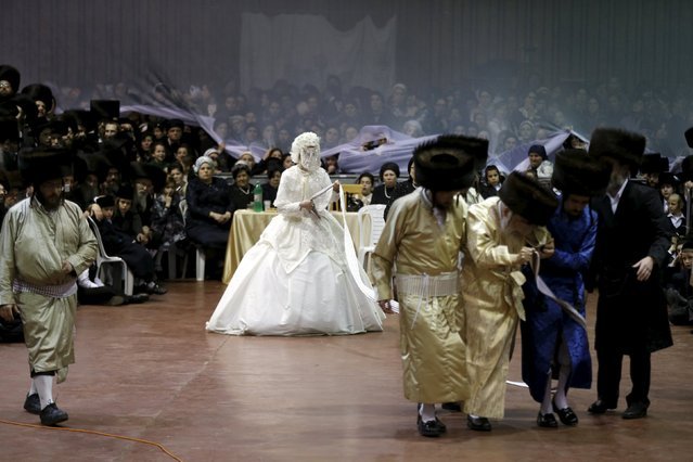 """An ultra-Orthodox Jewish bride takes part in the """"mitzva tantz"""", the custom in which relatives dance in front of the bride after her wedding ceremony, in Netanya, Israel, late March 15, 2016. (Photo by Baz Ratner/Reuters)"""