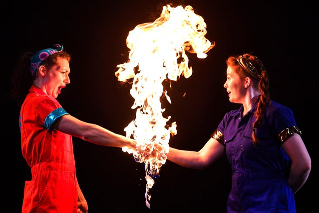 Aoife Raleigh (an engineer) and Maria Corcoran (a chemist) perform a fire act during the launch of Strong Women Science at the Pleasance, Edinburgh Science Festival's new Festival Hub on April 10, 2019 in Edinburgh, Scotland. Strong Women Science is a brand new circus science show at Edinburgh Science Festival starring two women scientists turned circus performers. In addition to demonstrating scientific principles in fun and accessible ways, it looks at the worth of failure and the power of teamwork, both shared by science and circus. (Photo by Jeff J. Mitchell/Getty Images)