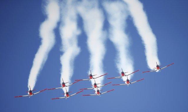 Members of the Swiss aerobatic team Patrouille Swiss fly in formation over the Alpine Skiing World Cup finals in St. Moritz, Switzerland March 19, 2016. (Photo by Arnd Wiegmann/Reuters)