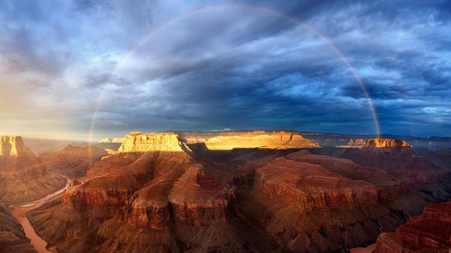 """Come rain and shine: """"tenacious scouting"""" and luck led to this shot of a rainbow over the Grand Canyon in Arizona. (Photo by Colin Sillerud)"""