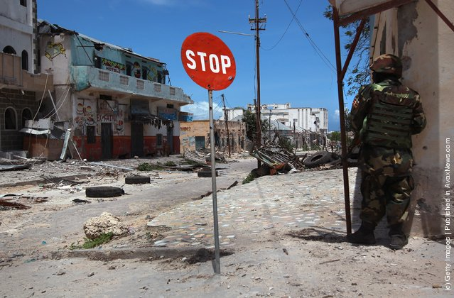 Ugandan soldier guards a street corner in the infamous Bakara market in Mogadishu, Somalia