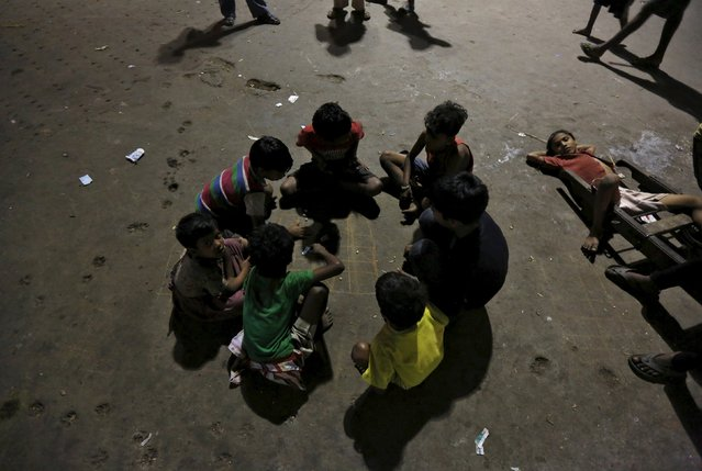Homeless children play in a parking area of a railway station in Kolkata, India, March 14, 2016. They spend their days and nights there. (Photo by Rupak De Chowdhuri/Reuters)