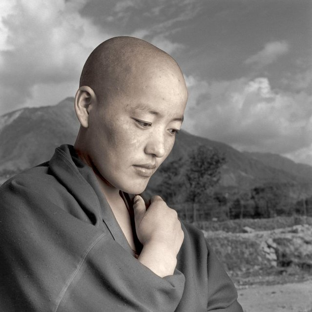 """Ngawang's lifelong desire was to become a nun but could not because of the restrictions set in Tibet. When she learned of the religious freedom and educational possibilities that were available in India she made the difficult decision to leave her family and home. She said ""It is terrible, but I could not be a true Tibetan if I stayed in my own country"". (Phil Borges)"