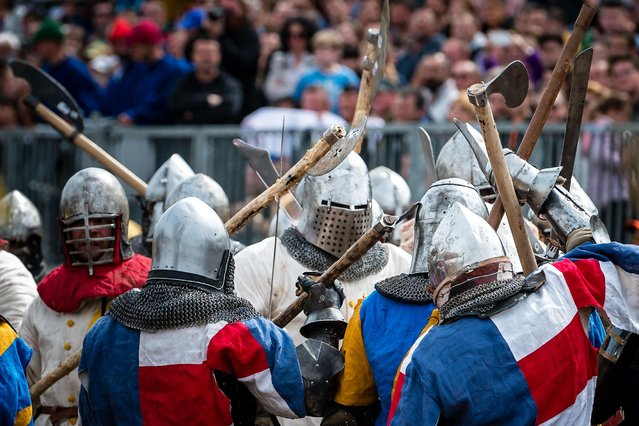 """Enthusiasts wearing armour fight during the medieval tournament """"Battle of the Nations"""" at the Smederevo fortress, in eastern Serbia, on May 5, 2019. Up to 25 countries are taking part in the annual historical medieval competition which was first held in Ukraine in 2009. (Photo by Andrej Isakovic/AFP Photo)"""