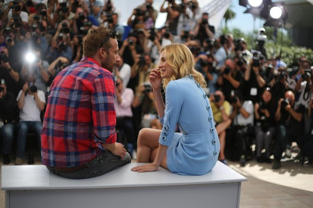 "Matthias Schoenaerts and Diane Kruger speak with each other at the photo call for the screening of the film ""Maryland"" (Disorder), at the 68th international film festival, Cannes, southern France, Saturday, May 16, 2015. (Photo by Joel Ryan/Invision/AP Photo)"