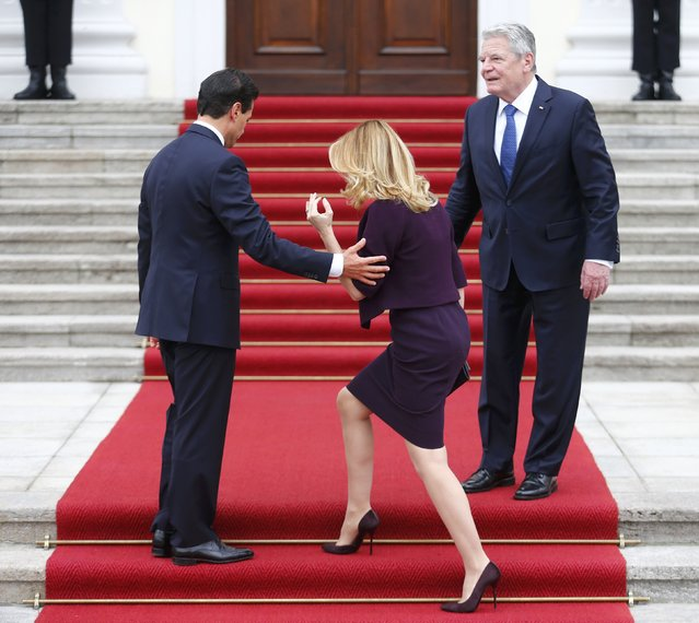Mexico's President Enrique Pena Nieto helps his wife Angelica Rivera as they are welcomed by German President Joachim Gauck (R) at the Bellevue presidential palace in Berlin, Germany, April 11, 2016. (Photo by Hannibal Hanschke/Reuters)