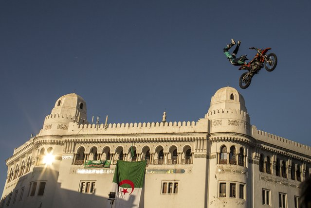 Belgian motorcycle acrobat Gilles Dejon performs during a freestyle motocross demonstration in Algiers, Algeria May 23, 2015. (Photo by Zohra Bensemra/Reuters)