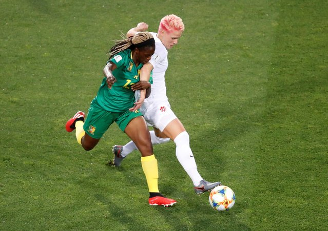 Sophie Schmidt of Canada (R) battles for possession with Claudine Meffometou of Cameroon during the 2019 FIFA Women's World Cup France group E match between Canada and Cameroon at Stade de la Mosson on June 10, 2019 in Montpellier, France. (Photo by Eric Gaillard/Reuters)