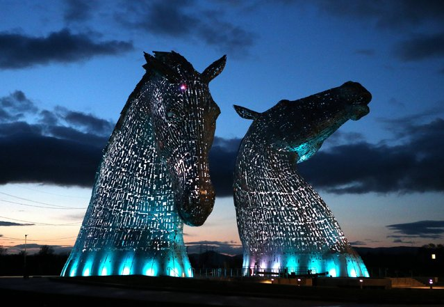 A lighting test is carried out on the Kelpies in Falkirk ahead of their  official opening to the public later this month, on April 7, 2014. Designed by sculptor Andy Scott each of The Kelpies stands up to 30 metres tall and each one weighs over 300 tonnes. (Photo by Andrew Milligan/PA Wire)