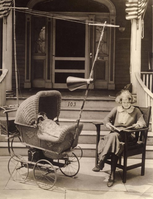 Invention to keep a baby content in its pram so that mother can read untroubled: the pram is provided with a radio, including antenna and loudspeaker. Instead of a baby, two dolls have been put in the pram to illustrate the goal of this invention. Date: 1921. (Photo by Mary Evans Picture Library/Caters News)