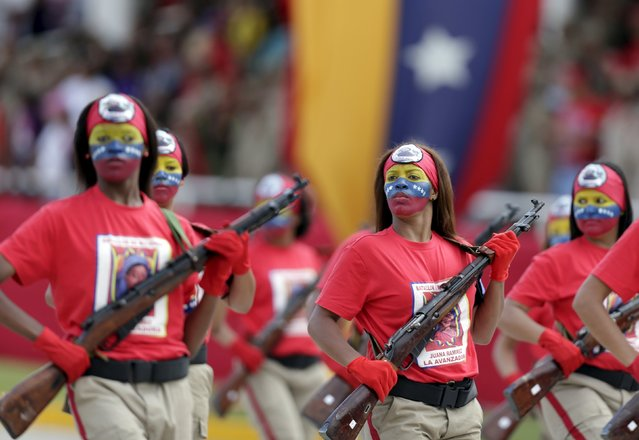 Female soldiers with their faces painted in the colours of the Venezuelan national flag, march during a military parade to celebrate the anniversary of Venezuela's independence in Caracas, July 5, 2015. (Photo by Jorge Dan Lopez/Reuters)
