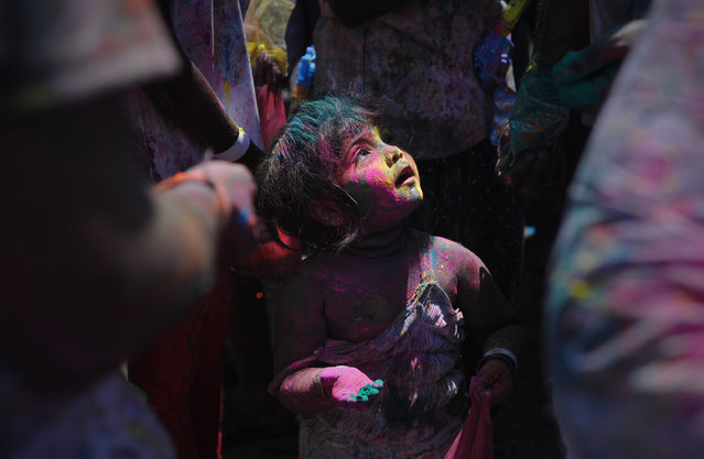 """""""A girl smeared with colors powder"""". A girl smeared with colors powder during Holi, the Hindu festival of colors in Kuala Lumpur on March 23, 2014.Holi, the Hindu festival of colors, is celebrated by people throwing colored powder and water at each other. Photo location: Kuala Lumpur. (Photo and caption by Firdaus Latif/National Geographic Photo Contest)"""