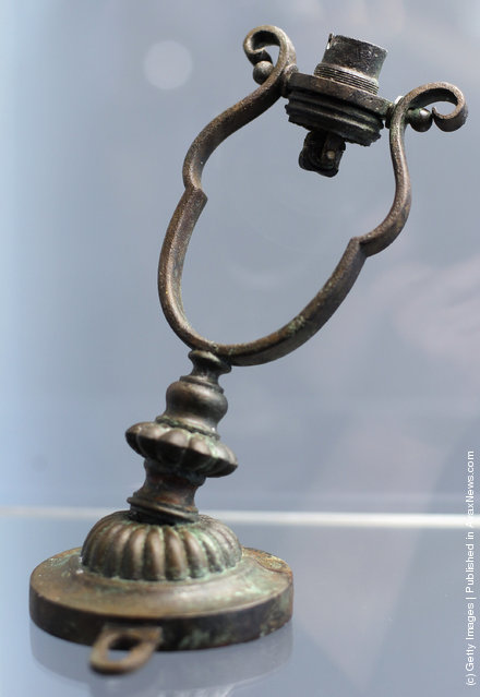 A Gimbal lamp is seen among artifacts recovered from the RMS Titanic