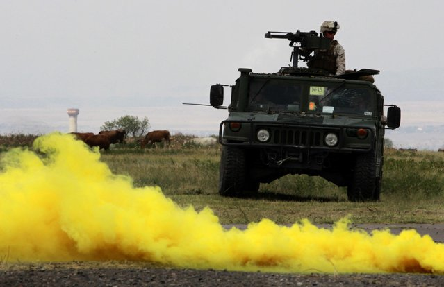 US soldier s drive a military vechicle during a joint NATO-Georgia military exercise at a military base in Vaziani, outside Tbilisi, Georgia, Tuesday, July 21, 2015. (Photo by Shakh Aivazov/AP Photo)