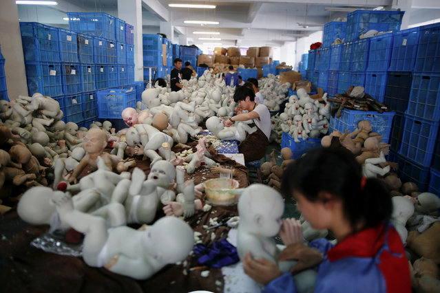 People work at Jinhua Partytime Latex Art and Crafts Factory in Jinhua, Zhejiang Province, China, May 25, 2016. (Photo by Aly Song/Reuters)