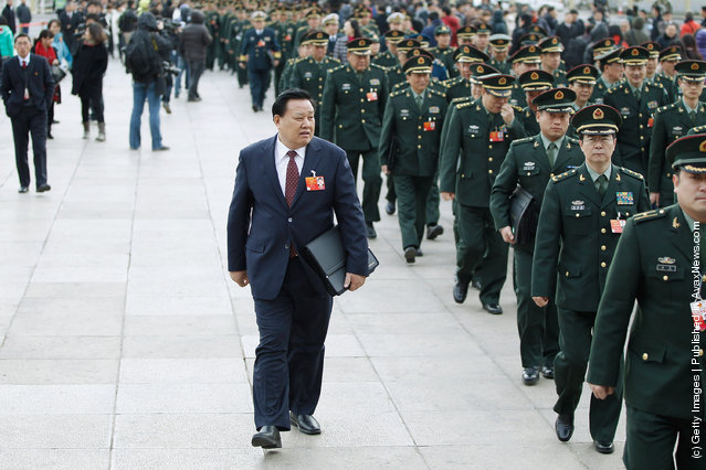 A delegate looks Chinese military delegates arriving at The Great Hall Of The People before the second plenary meeting of the National People's Congress (NPC)