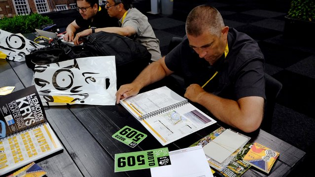 Reuters driver Jacques Clawey (R) checks the Tour de France 2015 cycling race road map in the media centre in Utrecht, Netherlands, July 1, 2015. (Photo by Stefano Rellandini/Reuters)