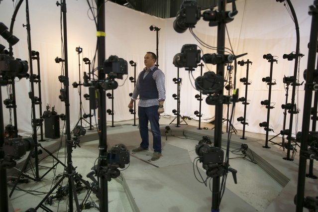 James Enright, CEO of  Propshop, stands in a scanning and photogrammetry rig at the company's headquarters at Pinewood studios near London, Britain May 25, 2016. (Photo by Peter Nicholls/Reuters)