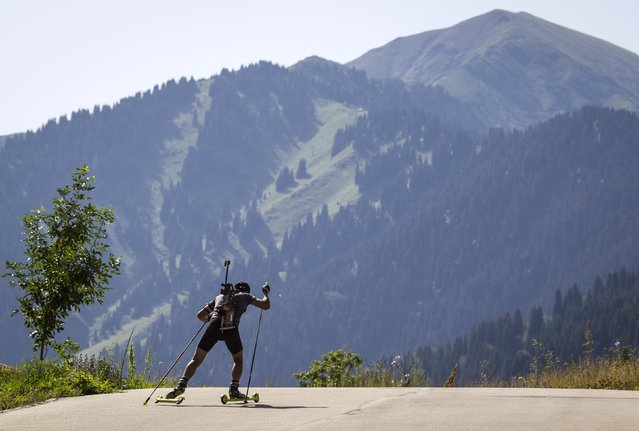 An athlete attends training session at the Ak Bulak Nordic Arena outside Almaty, Kazakhstan, July 16, 2015. (Photo by Shamil Zhumatov/Reuters)