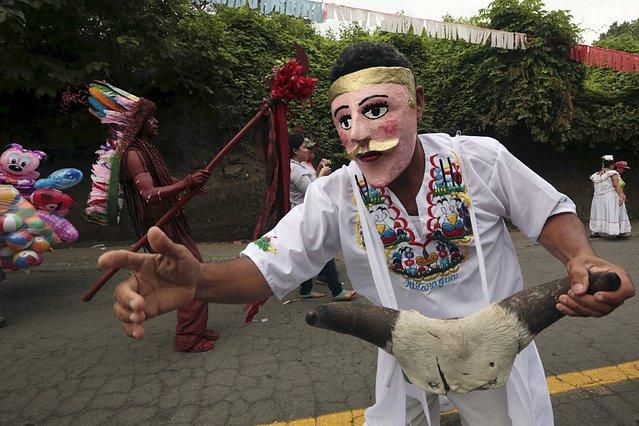 A masked dancer performs during celebrations honouring the patron saint of Managua Santo Domingo de Guzman in Managua, Nicaragua, August 1, 2015. (Photo by Oswaldo Rivas/Reuters)