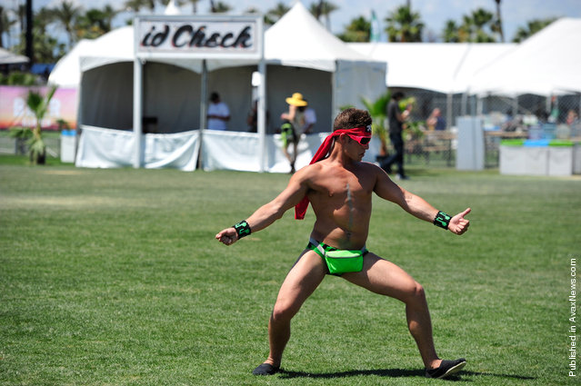 A Coachella music fan dances during Day 3 of Coachella 2012, on April 15, 2012