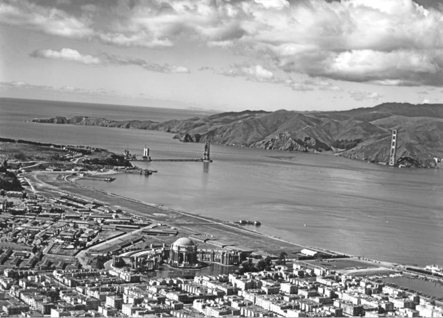 View from over the Marina and the Presidio of the Golden Gate Bridge under construction with the Palace of Fine Arts in the lower center, San Francisco, California, 1935. (Photo by Underwood Archives/Getty Images)