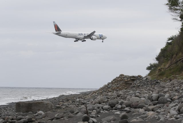An airplane flies over the Jamaique beach in Saint-Denis on the French Indian Ocean island of La Reunion, August 3, 2015. (Photo by Jacky Naegelen/Reuters)