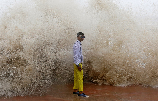 A boy poses for a photograph during a high tide in Mumbai, India June 27, 2017. (Photo by Shailesh Andrade/Reuters)