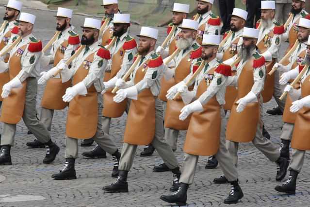 Members of the Foreign Legion parade during the traditional Bastille Day Parade on the Champs Elysees in Paris, Monday, July 14, 2014. (Photo by Remy de la Mauviniere/AP Photo)