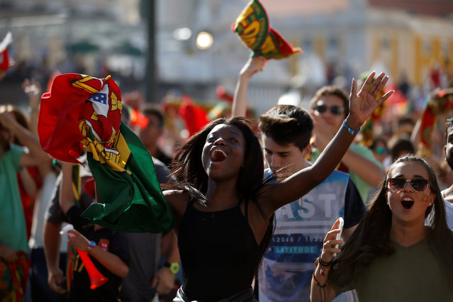 Fans of Portugal react as they watch the Euro 2016 match between Portugal and Hungary at a public screening in downtown Lisbon, Portugal, June 22, 2016. (Photo by Rafael Marchante/Reuters)
