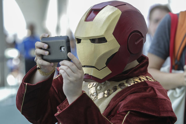 An Iron Man modified as an Iron Renaissance Man takes a photo during Comic-Con 2017 in San Diego, California, July 21, 2017. (Photo by Bill Wechter/AFP Photo)