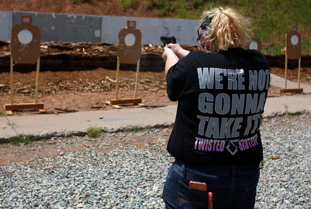 Mallory Washburn shoots at targets during a firearms training class attended by members of the Pink Pistols, a national pro-gun LGBT organization, at the PMAA Gun Range in Salt Lake City, Utah, U.S., July 1, 2016. (Photo by Jim Urquhart/Reuters)