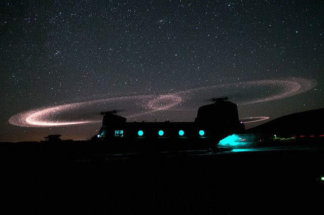 Dust lights up the rotors of a CH-47 Chinook helicopter as paratroopers with 3rd Squadron, 73rd Cavalry Regiment load for an air assault mission near Combat Outpost Ab Band, May 23, 2012, Ghazni province, Afghanistan. The unit is part of the 82nd Airborne Division's 1st Brigade Combat Team, which deployed to the area in March to help bring security to the areas along the country's main road between Kabul and Kandahar. (Photo by Sgt. Mike MacLeod/U.S. Army)