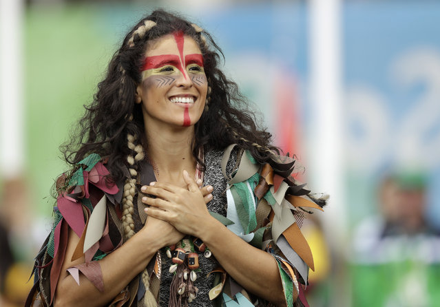 A dancer performs at a welcoming ceremony for athletes at the 2016 Summer Olympics in Rio de Janeiro, Brazil, Wednesday, August 3, 2016. (Photo by Robert F. Bukaty/AP Photo)