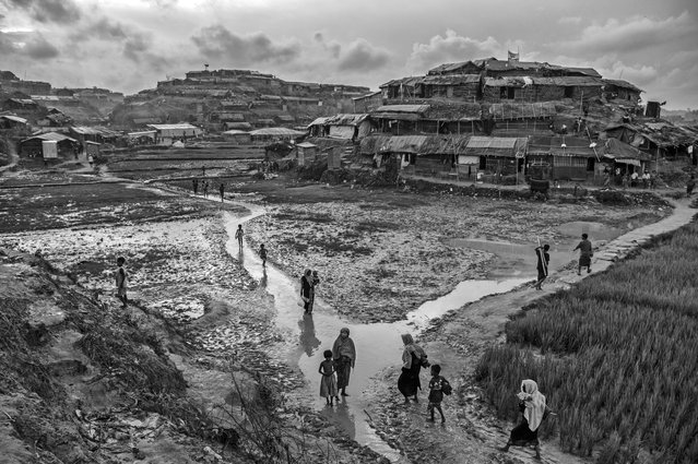 Rohingya refugees walk in the sprawling Balukali refugee camp, on October 2, 2017 in Cox's Bazar, Bangladesh. (Photo by Kevin Frayer/Getty Images)