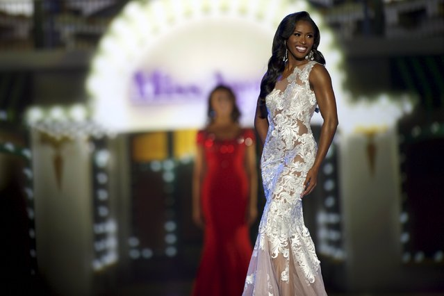 Miss South Carolina Daja Dial competes in the evening gown competition on the first night of preliminaries at the Miss America competition at Boardwalk Hall in Atlantic City, New Jersey, September 8, 2015. (Photo by Mark Makela/Reuters)