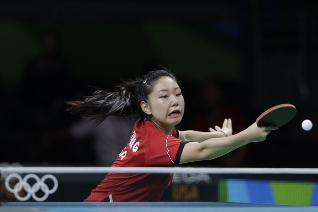 Lily Zhang of the United States competes against Jieni Shao of Portugal during their table tennis match at the 2016 Summer Olympics in Rio de Janeiro, Brazil, Saturday, August 6, 2016. (Photo by Petros Giannakouris/AP Photo)