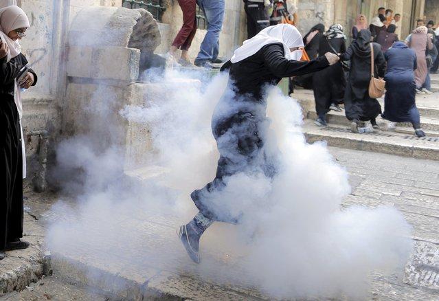 Palestinian women run away as Israeli police throw a stun grenade in Jerusalem's Old City September 13, 2015. (Photo by Ammar Awad/Reuters)
