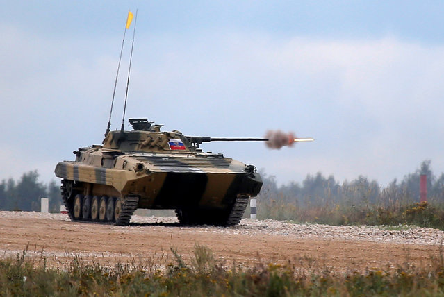 A BMP-2 amphibious infantry fighting vehicle, operated by a crew from Russia, fires at a target during a competition at the International Army Games 2016, at a range in the settlement of Alabino outside Moscow, Russia, August 13, 2016. (Photo by Maxim Shemetov/Reuters)