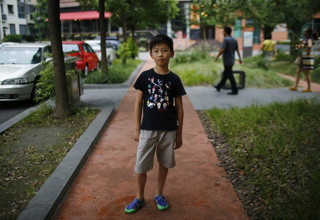 "Yu Yan, who was born in 2004, poses for a photograph in Shanghai August 24, 2014.  ""I want to have someone to play with"" said Yan. (Photo by Carlos Barria/Reuters)"