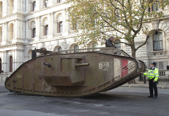Police officer and former Gulf War Tank Commander Spike Yarrow, speaks with tank driver Chris Fielder, a technician from The Tank Museum, in Bovington, Dorset, with a replica WW1 Mk IV tank used in the film Warhorse, at The Cenotaph, Whitehall in London, England on November 19, 2017. (Photo by Yui Mok/PA Images via Getty Images)