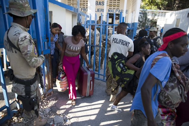 Haitians cross from the Dominican Republic into Malpasse, Haiti, Tuesday, March 17, 2020. Haitian authorities shutdown its border with the Dominican Republic on Monday as a precaution against the spread of the new coronavirus, banned travel for government officials, and suspended flights from Europe, Canada, the Dominican Republic, and Latin America. The vast majority of people recover from the new virus. (Photo by Dieu Nalio Chery/AP Photo)