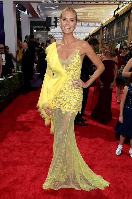 Heidi Klum arrives at the 67th Primetime Emmy Awards on Sunday, September 20, 2015, at the Microsoft Theater in Los Angeles. (Photo by Charles Sykes/Invision for the Television Academy/AP Images)