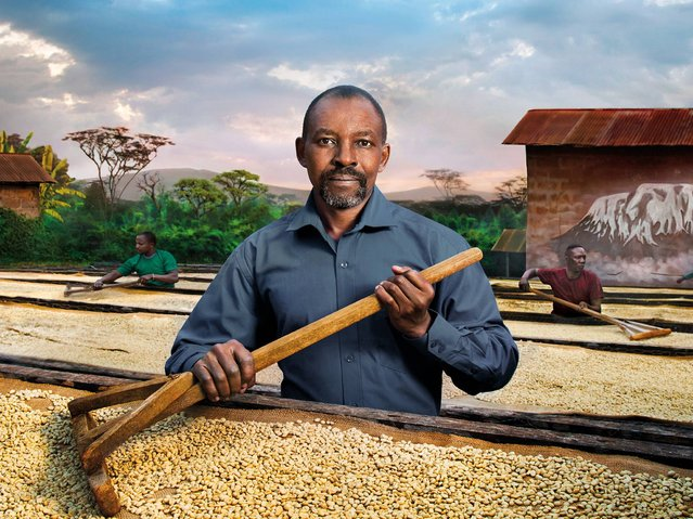"""""""Kirua calls Tierra"""". Father Peter Kilasara, a Tanzanian missionary in the Congregation of the Holy Spirit, he has worked in various countries and is at present the determined leader of the Kirua Children Association in Tanzania. He is surrounded by an expanse of coffee beans drying in the sun, as a defender and protector of his tradition in Tanzania. (Photo by Steve McCurry/2015 Lavazza Calendar)"""