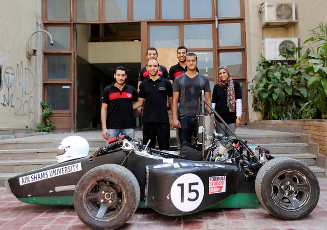 An Egyptian university students team pose behind the racing car they built to compete at Formula Student UK in Cairo, Egypt September 2, 2016. (Photo by Mohamed Abd El Ghany/Reuters)